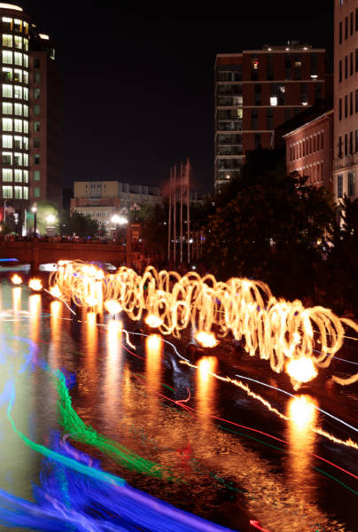 Fire spinners long exposure during WaterFire Clear Currents